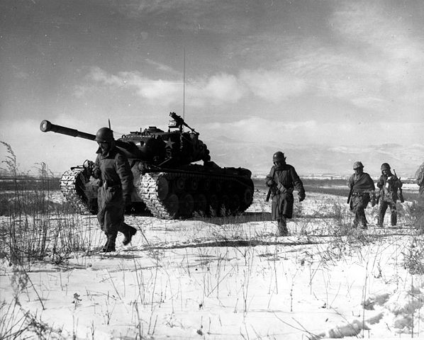 photo of American Marines walking beside a tank in Korea for Will You Send Your Child to Battle poem
