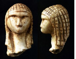 Photo of a Paleolithic carving of a woman's head, the Venus_of_Brassempouy