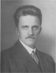 Photo of man with a mustache and neat hair