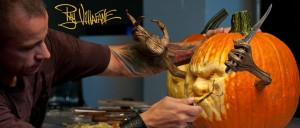 Photo of Ray Villane carving a pumpkin