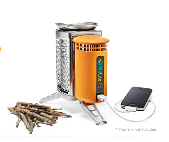 Camp stove charges smart phone
